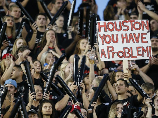 Cincinnati Bearcats fans cheer on the team in the first