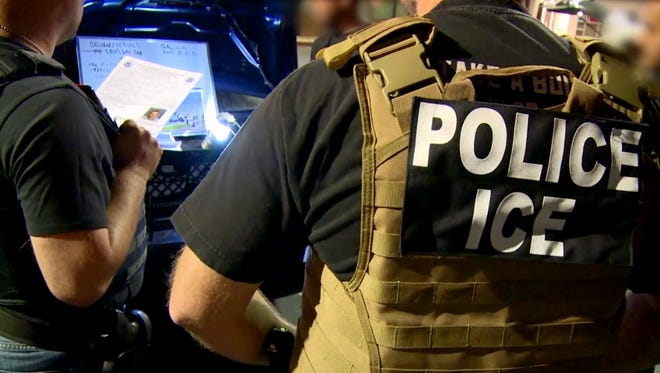ICE agents plan an arrest in the Los Angeles area.