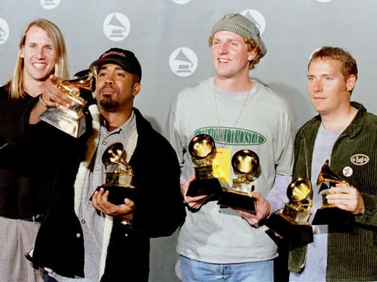 "Hootie and the Blowfish featuring Darius Rucker (second from let) pose for photographers with their Grammy Awards for Best New Artist and Best Pop Performance by a Group with Vocal for ""Let Her Cry"" at the 38th annual Grammys in 1996."