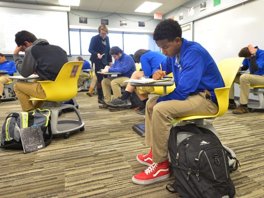 Tenth grader Amanuel Hailemarian studies in class at