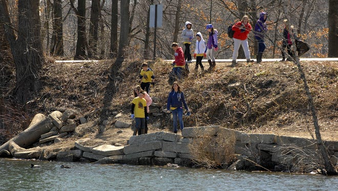 Pequannock Mayor's Annual Riverbank Cleanup is set for Saturday, April 1. Volunteers pictured cleaning up the river in recent years.