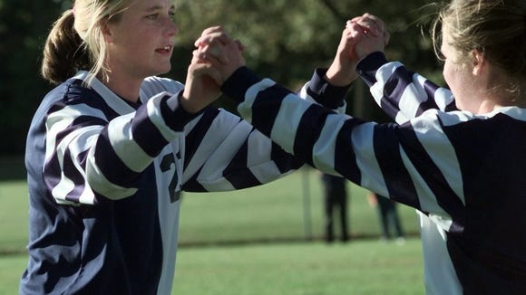 Abby Wambach, left, during her senior year at Mercy in 1997.