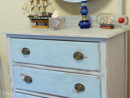 Buford used light blue chalk paint to update an old dresser.