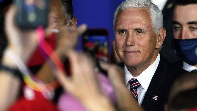 Vice President Mike Pence greets supporters after speaking at a campaign rally, Tuesday, Sept. 22, 2020, at Lanconia Municipal Airport in Gilford, N.H.