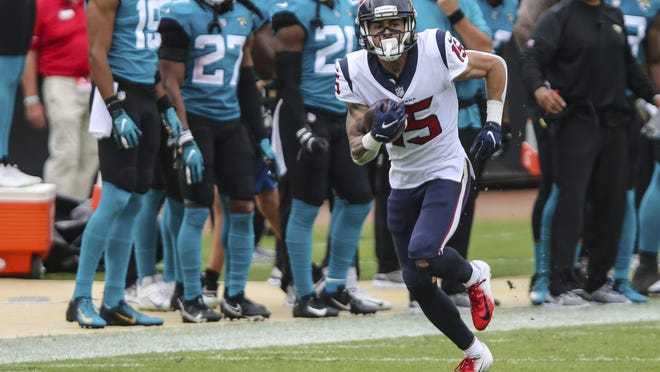 Houston Texans wide receiver Will Fuller hunts for running room during his 77-yard receiving touchdown in Sunday's win over the Jacksonville Jaguars. Fuller, who was subject to trade rumors at the deadline, had 100 receiving yards in the victory.