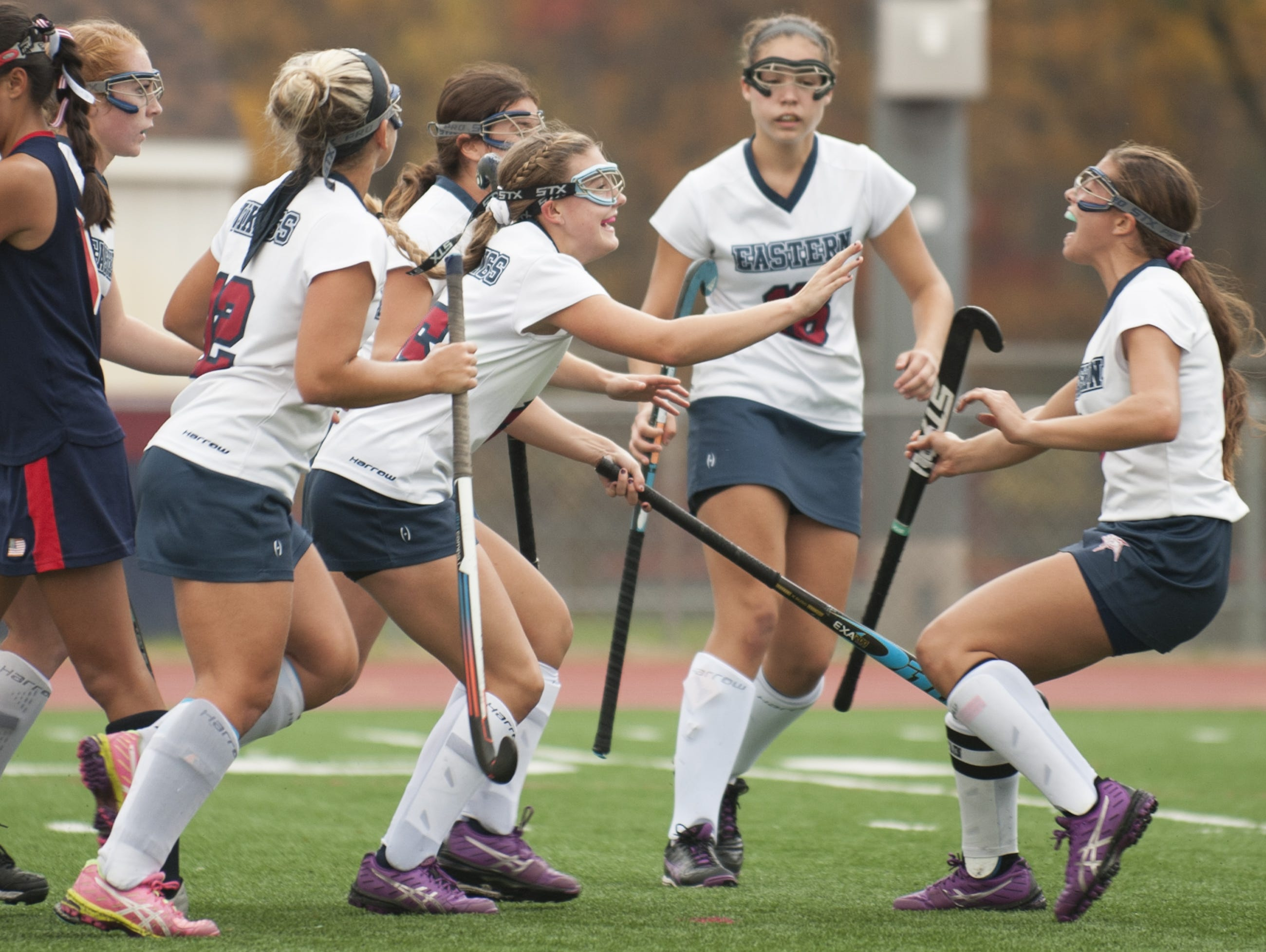 Eastern's Jessica Maute, center, celebrates with teammates after Maute scored a goal in the first half of the South Jersey Group 4 field hockey final. Eastern prevailed with an 8-1 win over Washington Township.