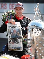 Winner of the102nd running of the Indianapolis 500 Will Power poses for photos with the Borg-Warner Trophy and the front page of the Indianapolis Star at Indianapolis Motor Speedway on Monday, May 28, 2018.