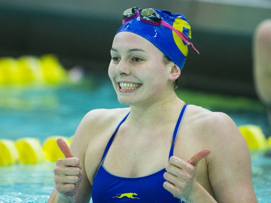 A smiling Claire Adams, Carmel, after winning the 100 yard freestyle, IHSAA girls swimming and diving sectional, Feb. 6, 2016.
