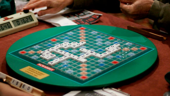 FILE - In this Thursday, Nov. 17, 2005, file photo, competitors take part in the World Scrabble Championships at an hotel in north west London. The Association of British Scrabble players has banned one of its star players, Allan Simmons, for three years after an independent investigation concluded that he had broken the rules of the popular game, it was reported on Monday, Nov. 13, 2017. (AP Photo/Matt Dunham, File)