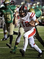 November 4, 2016 - Rossview junior QB Gino Avros (#12) breaks through the Central defense for a first half TD in a first-round TSSAA Class 5A state playoff game.