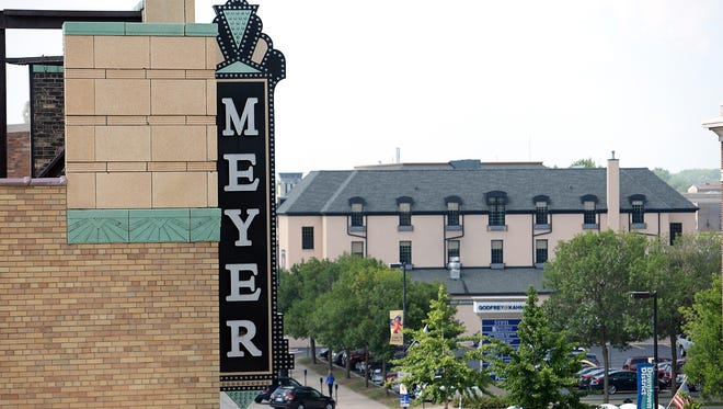 The Meyer Theatre sign overlooking Washington Street in Green Bay viewed from the rooftop of Backstage at the Meyer July 10, 2015.