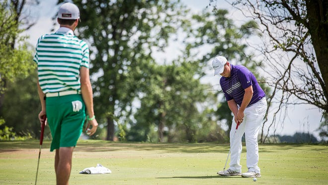 Central's Keenan Bronnenberg faces off against Yorktown's Blake Vise in an overtime match at the Hickory Hills Golf Course Monday, June 6, 2016.