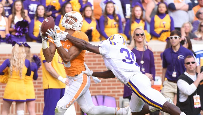Tennessee wide receiver Josh Malone makes a touchdown catch in front of Tennessee Tech safety Ricky Ballard during the first half at Neyland Stadium on Saturday, Nov. 5, 2016.