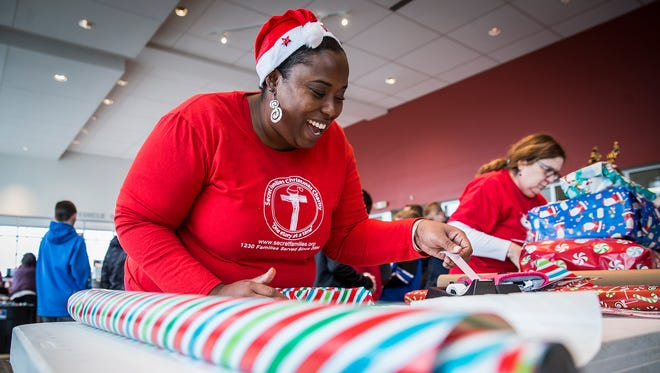 Thousands of volunteers worked in three shifts to buy, wrap and deliver presents to families during the annual Secret Families Christmas Charity event at Toyota of Muncie in December 2016.
