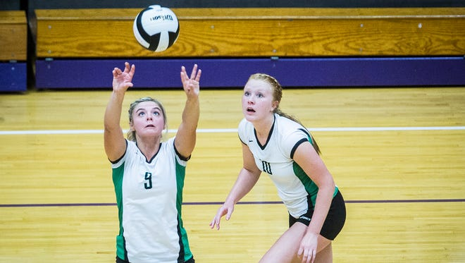 Yorktown's Bella Rosenthall sets against Central at the Muncie Fieldhouse Thursday, Aug. 17, 2017.
