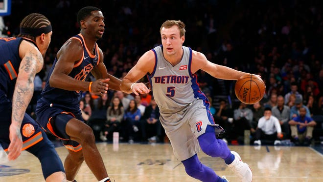 Pistons guard Luke Kennard drives to the basket against Knicks guard Damyean Dotson during the first half on Saturday, March 31, 2018, in New York.