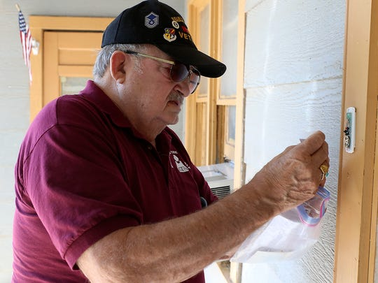 Volunteer Ray Favre installs a free doorbell at a home on San Angelo's north side, Friday, Oct. 6, 2017. Supported by the East Lions Club, Favre initiated the idea to give out free doorbells.