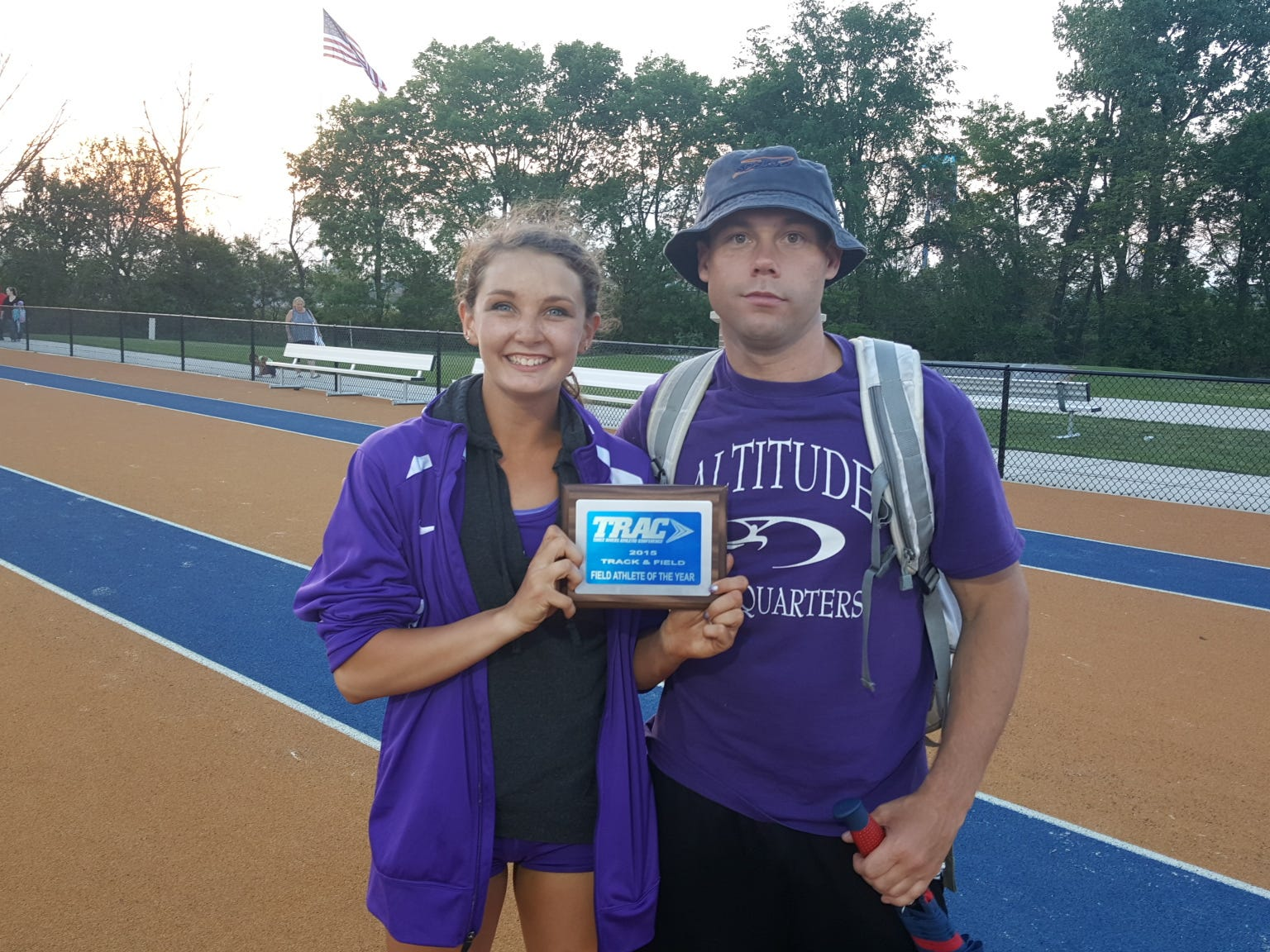 Fremont Ross's Amber Otermat holds a plaque recognizing her as the Three Rivers Athletic Conference's 2015 Field Athlete of the Year at Friday's conference championship meet.