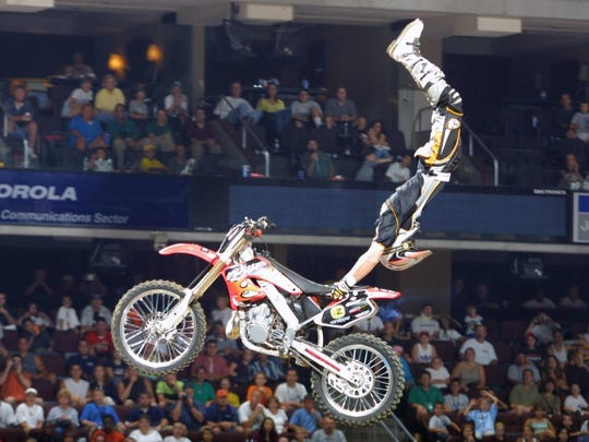 Motocross riders from the U.S. and Canada show off their tricks July 31 during the Montana State Fair.