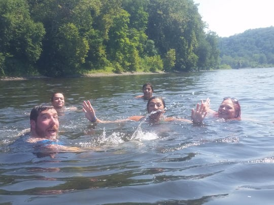 The 13weeks crew after jumping off the tubes to swim.