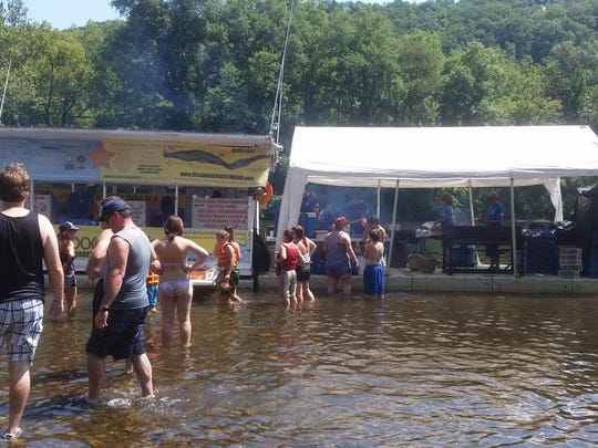 """The floating """"Famous River Hotdog Man,"""" where patrons get a free lunch if they rent from Delaware River Tubing."""