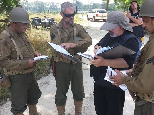 Going through the scene with the script. Left to right: actors Lawrence Gamell Jr. and Tom Stedham, director Joseph Lawson and actor Yaron Urbas.