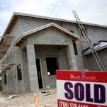 A sold sign is seen in front of a new single family home on April 16, 2014 in Miami.