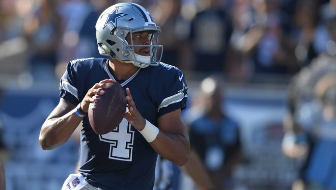 Dallas Cowboys quarterback Dak Prescott passes against the Los Angeles Rams in the first half of a preseason NFL football game Saturday, Aug. 13, 2016, in Los Angeles.