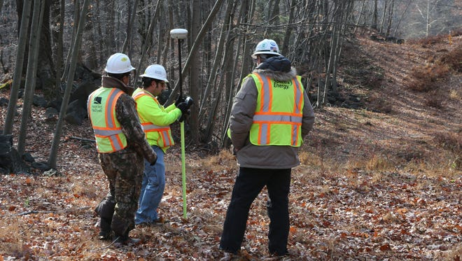 A crew from Spectra Energy surveys an area on the existing gas pipeline easement in the Blue Mountain Reservation area in Cortlandt Nov. 20, 2014.