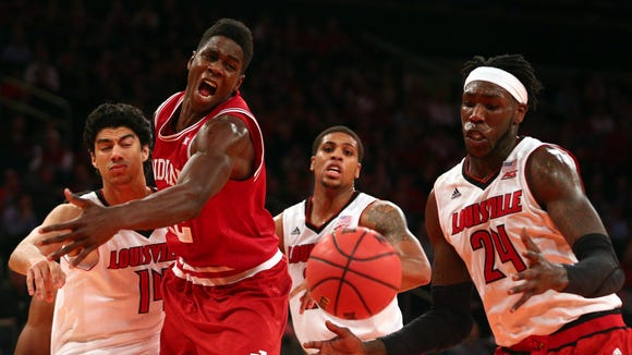 Indiana Hoosiers forward Hanner Mosquera-Perea (12) reaches for a rebound with Louisville Cardinals forward Anas Mahmoud (14) and Louisville Cardinals guard Wayne Blackshear (25) and Louisville Cardinals forward Montrezl Harrell (24) at Madison Square Garden.