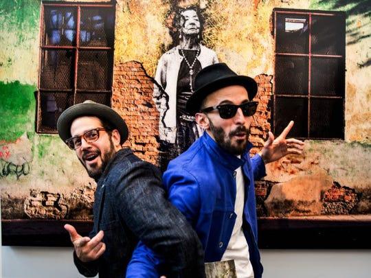 "Jose? Parl?a, left, director of ""Wrinkles of the City – La Havana,"" with artist JR."