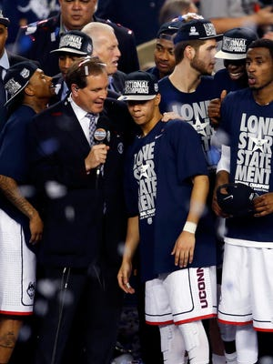 CBS announcer Jim Nantz interviews Connecticut Huskies guard Shabazz Napier (13) after the Huskies beat the Kentucky Wildcats in the championship game of the Final Four.