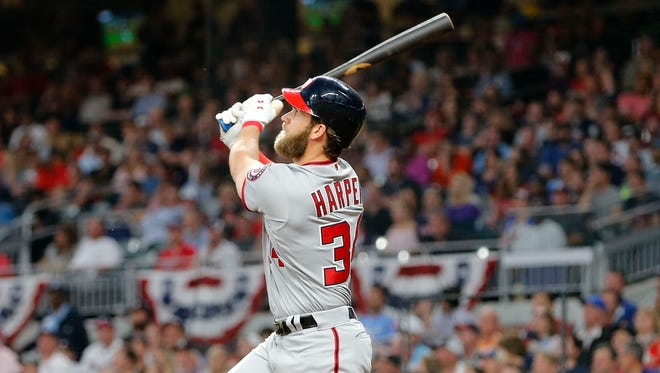 Washington's Bryce Harper watches his grand slam during a game Wednesday in Atlanta. It was Harper's second homer of the game.