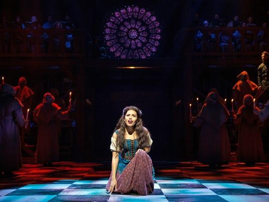 "Ciara Renée as Esmeralda and the company of ""The Hunchback"