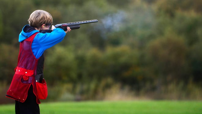 Robbie Carpenter, 10, shoots trap with other members of the Mason-Dixon Clay Busters.