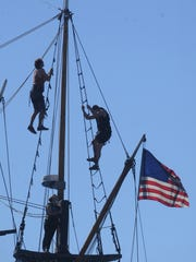 Crew members of the Hawaiian Chieftain work high above the deck to maintain the rigging while the ship is docked at Channel Islands Harbor during an earlier visit to Oxnard.