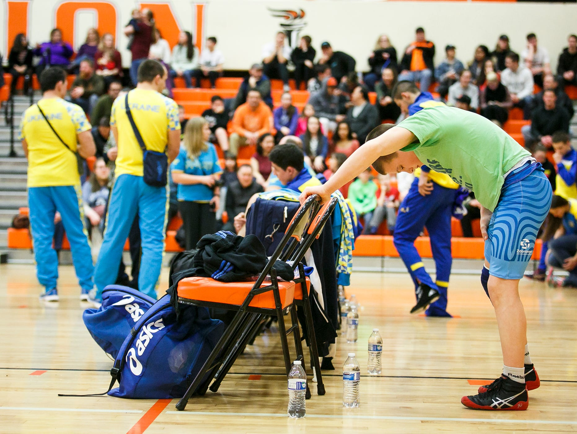 Oleh Haider from Ukraine stretches before the start of a friendly meet with Salem area All-Stars at Sprague High School on Tuesday, March 8, 2017. Haider is a member of the Ukrainian Junior National Wrestling Team, which faced Salem wrestlers in a freestyle wrestling match.