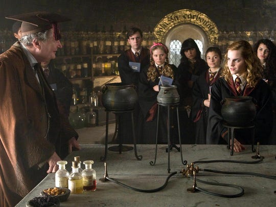 Jim Broadbent, left and Emma Watson in a scene from
