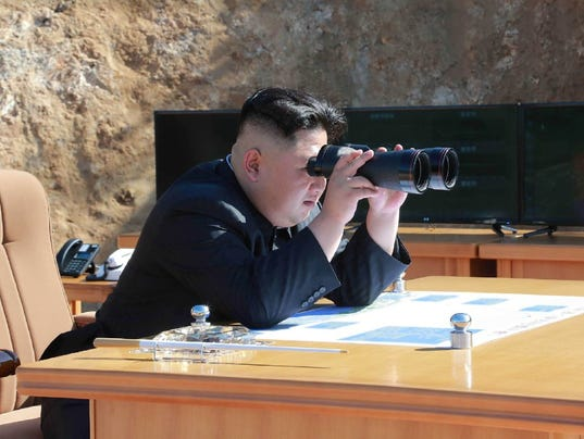 North Korean leader Kim Jong Un inspects the test-fire of an  intercontinental ballistic missile at an undisclosed location on July 4.