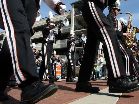 The Central Kitsap Marching Band marches down Fourth Street duiring the Armed Forces Day Parade in Bremerton, Wash. on Saturday, May 19, 2012. (AP Photo/Kitsap Sun, Meegan M. Reid)