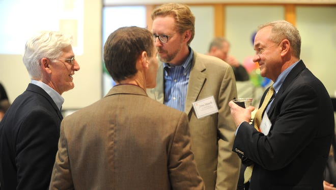 From left, Rob Hutter of The Commonwealth Companies; Tom Schneider of Silica Appliance and Electronics; Jon Mark Bolthouse of the Fond du Lac Public Library and Gary Ott of U.S. Bank attended the Fond du Lac County Economic Development Corporation social at the UW-Fond du Lac Atrium on Thursday.