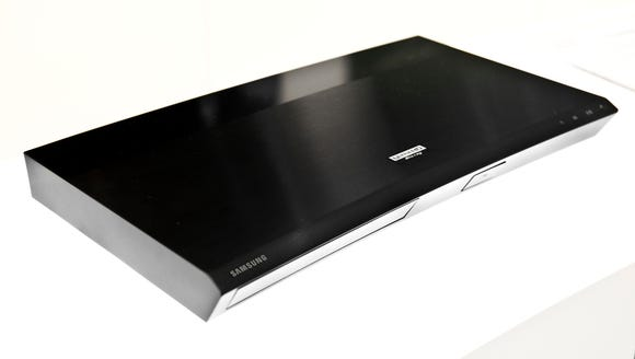 4K Ultra HD Blu-ray Disc players, such as Samsung's, can play 4K Blu-ray discs, normal high-definition Blu-ray discs, DVDs and CDs.