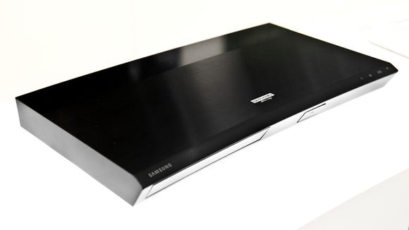4K Ultra HD Blu-ray Disc players, such as this one from Samsung, will play 4K Blu-ray Discs, regular high-def Blu-ray Discs, DVDs and CDs.