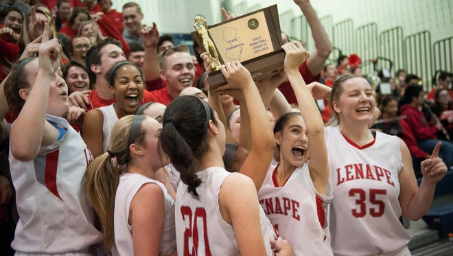 The Lenape girls' basketball team celebrates after their 50-35 win over Paterson Kennedy in the Group 4 state championship game at Pine Belt Arena in Toms River on Sunday. It was the program's first state crown.