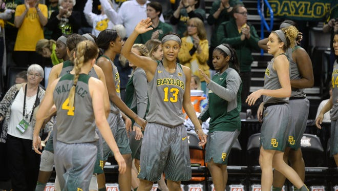 The Baylor Bears celebrate after defeating the Texas Longhorns during the women's Big 12 conference tournament at Chesapeake Energy Arena.