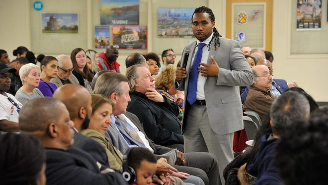 Christopher Irving, a Teaneck schools superintendent finalist, speaks to the crowd gathered at the high school on Thursday night.