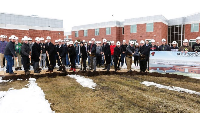 Fond du Lac High School faculty and students, with the help from area business leaders and local representitives break ground Wednesday April 18, 2018 for a new architecture, construction and engineering classroom facility which will be built on to the high school. Doug Raflik/USA TODAY NETWORK-Wisconsin