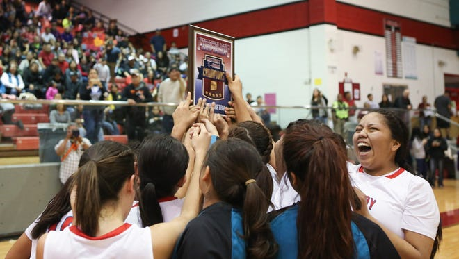 The Shiprock Lady Chieftains celebrate their victory over Kirtland Central in the District 1-4A Tournament championship game Friday at the Chieftain Pit in Shiprock.