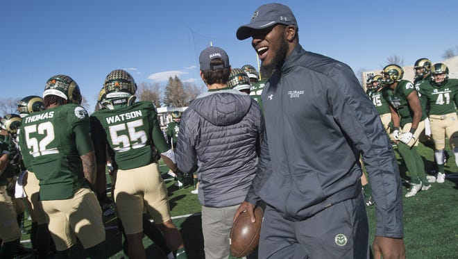 CSU's Deonte Clyburn huddles up with the Rams before a game against San Jose State at CSU Stadium on Saturday. The senior missed the final two seasons of his career because of blood clots.