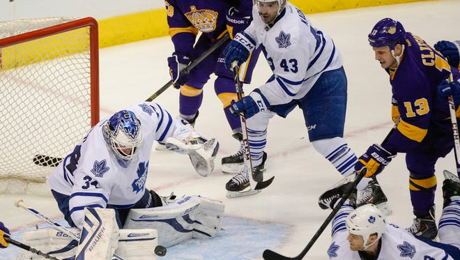 Toronto Maple Leafs goalie James Reimer (34) makes a save against Los Angeles Kings left wing Kyle Clifford (13) during the third period at Staples Center. Toronto won 3-2.
